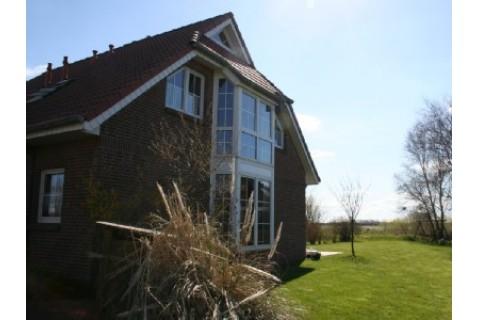 Ferienhaus AmAltenDeich**** mit Garten