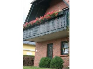 Hauseingang mit Balkon, Ferienhaus | Heise in Göhren-Lebbin