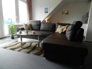 Wohnzimmer mit Ledersofa, Ferienwohnug Wattenläufer in Dorum bei Bremerhaven