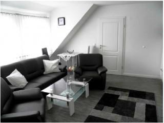Wohnzimmer/ Wohnung Bovenan-Black, Ferienwohnungen Krummhörn, Greetsiel in Krummhörn, Greetsiel